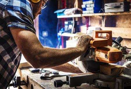 Carpenter using sawmill