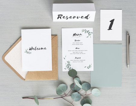 Ariel view of a dinner invite, table card placement and a menu