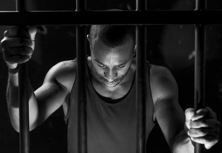 African American man behind bars Stock Photo - 89608817