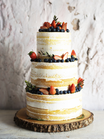 White Wedding Cake with Berries Decoration