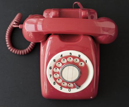 Retro red desktop telephone Фото со стока