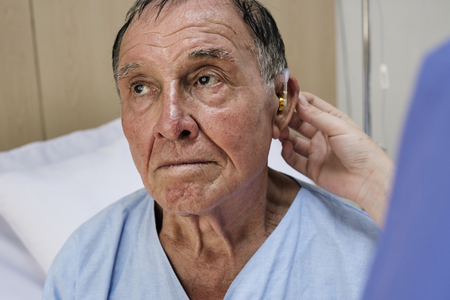 Old man wearing hearing aids Banco de Imagens