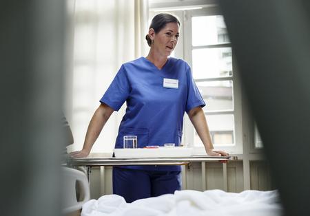A nurse serving food to a patient Banco de Imagens - 89668123