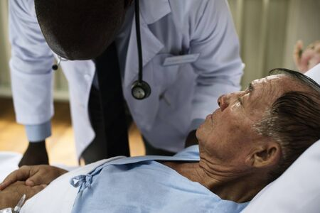 A sick elderly is staying at a hospital