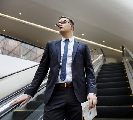 Business Man Walking Down Escalator Concept