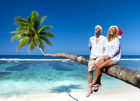 celebration: Couple relaxing on the beach during Christmas