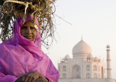 Indigenous Indian woman and the Taj Mahal as a background. Stock Photo