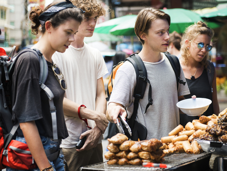 A group of tourists buying Thai Food at food stall 版權商用圖片