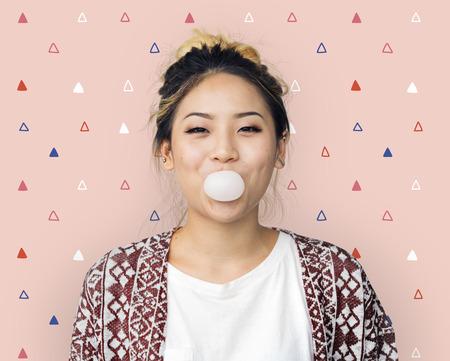 A studio portrait of young Asian woman Banco de Imagens