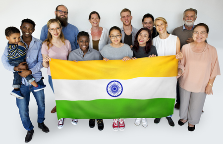 Group of people holding indian flag studio portrait