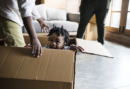 Family unpacking together in new place Stock Photo