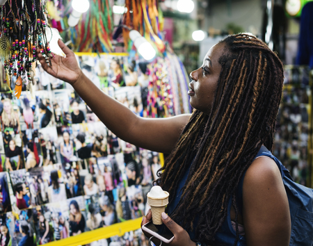 A female tourist choosing dreadlock extension