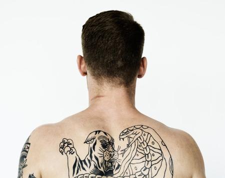 A man full of tattoos
