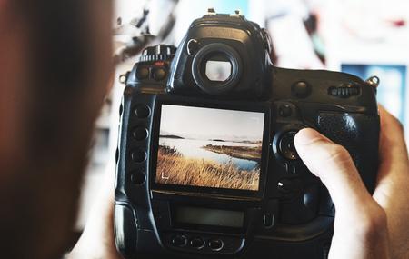 Man viewing photos on his camera