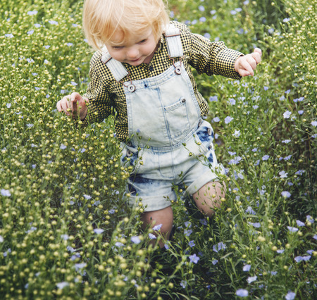 Kid in flower field
