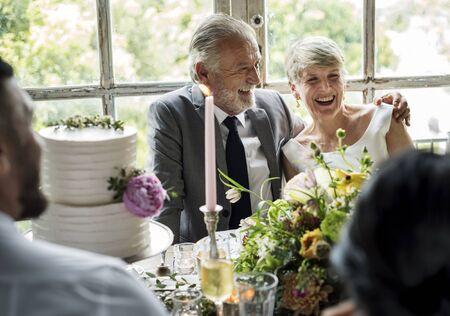 Senior Caucasian Couple Sitting Together Cheerful Banco de Imagens