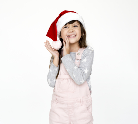 A girl with christmas hat portrait on the white background Stock Photo