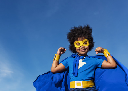 Cute little superhero girl with afro