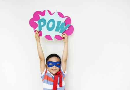 Superhero boy with a soundeffect Stock Photo