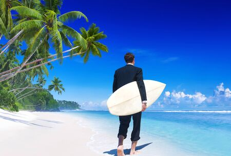 Businessman on vacation at a beach Stock Photo