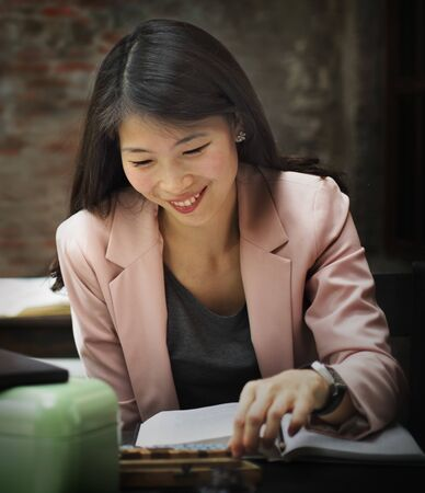 Businesswoman Reading Research Planning Concept