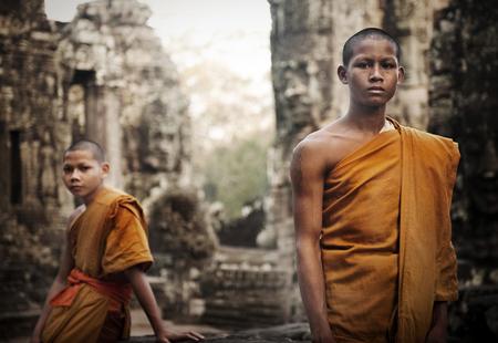Contemplating monk, Angkor Wat, Siem Reap, Cambodia.