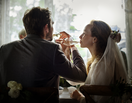 Couple at the wedding day reception table Stock Photo