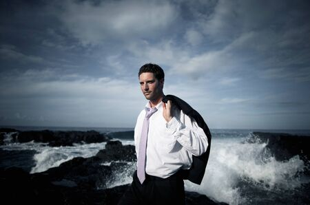 Businessman and a stormy ocean