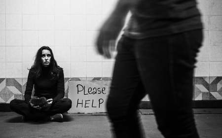 Homeless Beggar Woman Asking for Money Donation with Please Help Sign