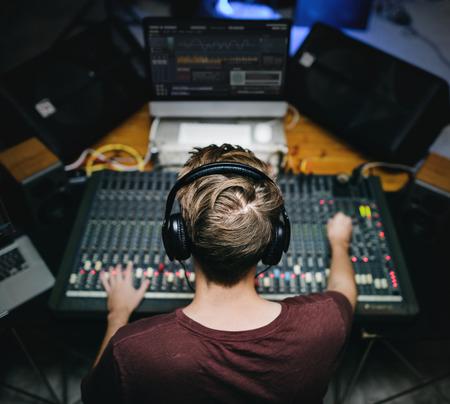 Man at sound mixer station