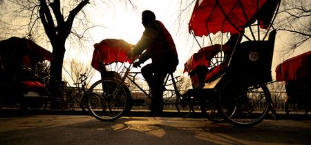 Man riding a Rickshaw.
