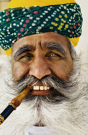 India man smoking a pipe.