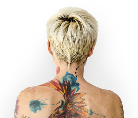 Young woman with tattoos on her back
