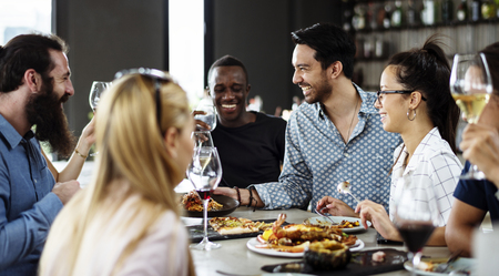 Group of friends having lunch together Stock Photo