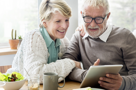 Senior couple using a tablet