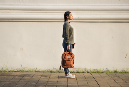 Asian woman carrying a bag