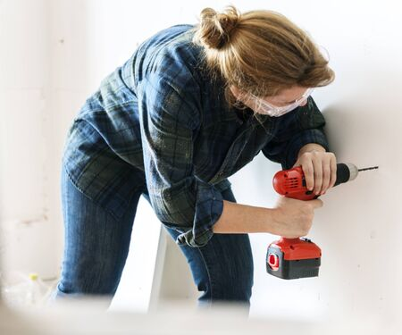 Constractor handyman working and using screwdriver Stock Photo