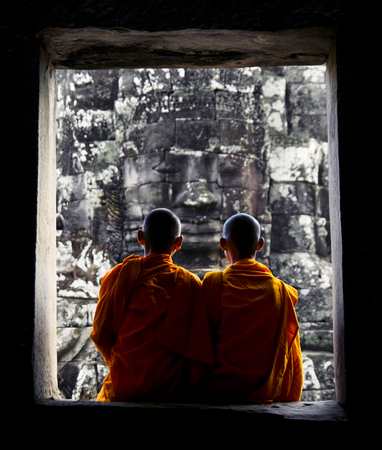 Contemplating monks, Angkor Wat, Siam Reap, Cambodia.