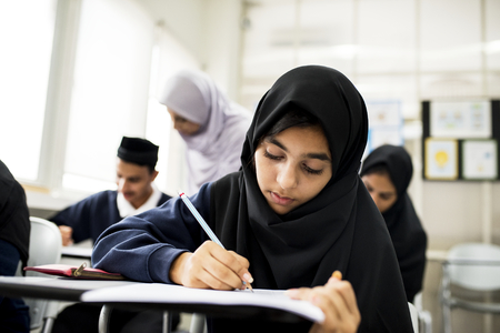 diverse muslim children studying in classroom Archivio Fotografico