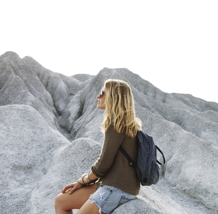 Woman take a rest from hiking on the rock