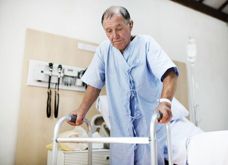 A sick elderly is staying at a hospital Banco de Imagens - 90600808