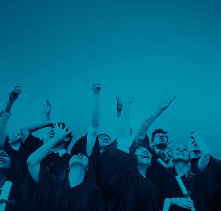 空気で帽子を投げて卒業生 写真素材