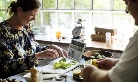 Man and woman preparing a meal