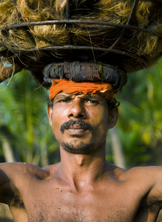 Indigenous manual labor worker carrying on the head.