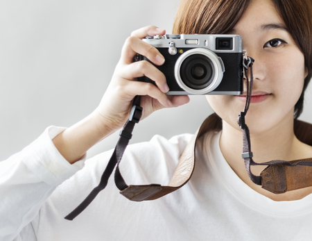 An Asian woman taking photographs