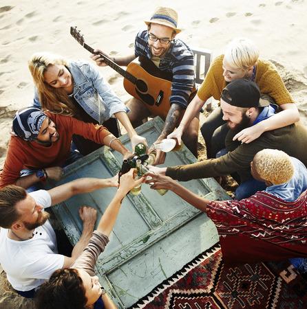 Friends having a beach party 版權商用圖片