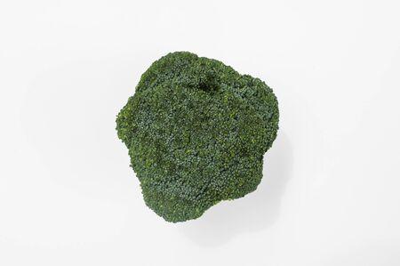 Closeup of fresh real broccoli isolated on white Banco de Imagens