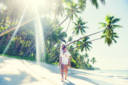 Couple at a tropical beach on Samoa Stock Photo