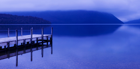 Tranquil peaceful lake with jetty, New Zealand. Stock Photo