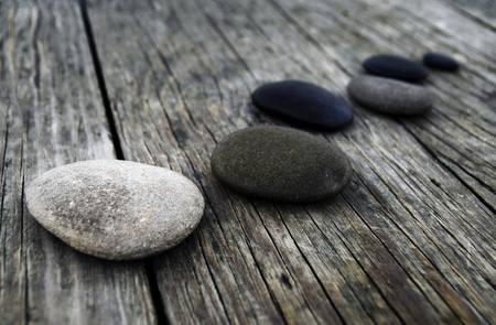 Smooth pebbles on an old wooden pier.